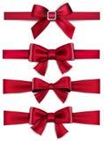 Ленты красного цвета сатинировки Смычки подарка Стоковые Изображения RF