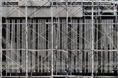 Леса конструкции высотного здания стоковые фото