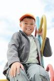лестница мальчика взбираясь сидя Стоковая Фотография RF