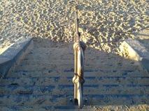 Лестницы исчезают в песке Стоковые Изображения