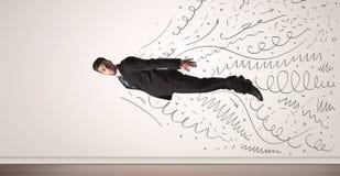 Летание бизнесмена при нарисованная рука выравнивает приходить вне Стоковые Изображения