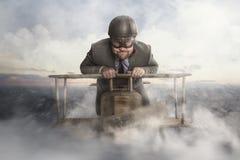 Летание бизнесмена с деревянным самолетом игрушки иллюстрация штока