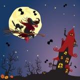 Летание ведьмы и черного кота на венике Стоковое Фото