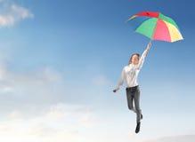 Летание девушки с зонтиком Стоковая Фотография