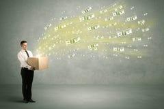 Летание денег от концепции коробки Стоковое фото RF