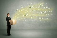Летание денег от концепции коробки Стоковое Фото