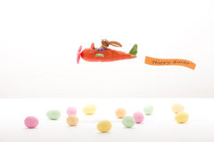 Летание зайчика пасхи в Морков-самолете Стоковые Фото