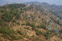 Летание над Pokahara, Непалом Террасы риса стоковое фото