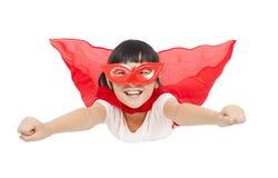 Летание ребенк супергероя изолированное на белой предпосылке стоковое фото rf