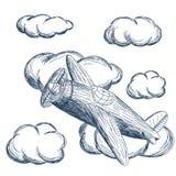 Летание самолета в облаках Стоковая Фотография