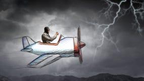Летание человека в плоскости ретро  Мультимедиа Стоковая Фотография RF