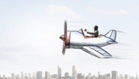 Летание человека в плоскости ретро  Мультимедиа Стоковая Фотография