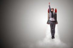 Летание человека с ракетой в концепции дела стоковое фото