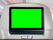 Летные развлечения с зеленым экраном, экраном Seatback с зеленым экраном в самолете Стоковое Изображение RF