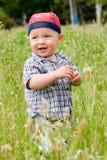 лето лужка llittle мальчика зеленое стоковые фотографии rf