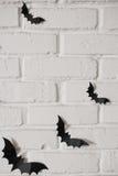Летучие мыши бумаги на стене Стоковое Фото
