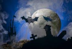 Летучие мыши на фоне луны, хеллоуина Стоковое Изображение