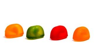 Леденцы на палочке конфеты изолированные на белизне Стоковые Фото