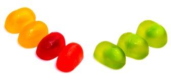 Леденцы на палочке конфеты изолированные на белизне Стоковая Фотография