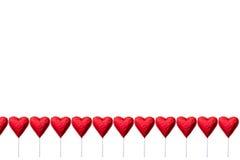 Леденцы на палочке шоколада в форме сердц Стоковые Изображения