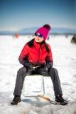 Лед-рыбная ловля женщины в зиме Стоковое Изображение