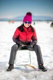 Лед-рыбная ловля женщины в зиме Стоковые Изображения RF