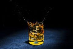 Лед с жидкостный брызгать Стоковая Фотография