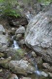 Ливневый поток в камне Стоковая Фотография RF