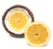 Лимон внутри и около кокоса изолированного на белизне Стоковое Фото