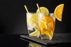 Лимон и настоянные апельсином воды Стоковое фото RF