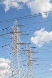 Линии передачи энергии против голубого неба Стоковое Изображение