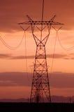 линии электричества заход солнца небес Стоковая Фотография
