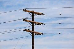 Линии электропередачи и поляки телефона трансформаторов Стоковые Изображения RF