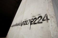линия восковка надписи на стенах номера Стоковые Изображения RF