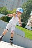 линия кататься на коньках ребенка Стоковая Фотография
