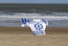 линия одежд свитер добыч военно-морского флота Стоковые Фотографии RF