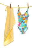линия одежд s ребенка купая пляжа одевает полотенце Стоковые Фотографии RF