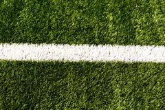 Линия текстура травы стадиона футбольного поля футбола предпосылки шарика Стоковые Фото