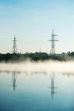 Линия электропередач в тумане Стоковые Изображения