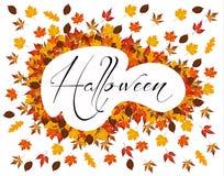 Листья осени с словом хеллоуином в центре стоковое изображение