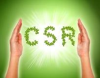 Лист аранжировали в форме csr с поддерживая руками Стоковые Изображения RF
