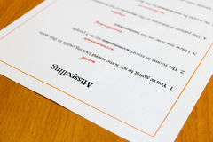 Лист опечатки на таблице Стоковое Изображение RF