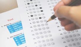 Лист ответа и английское испытание по стол Стоковое Фото