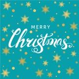 Литерность руки рождества на голубой предпосылке с золотыми звездами Стоковые Фото