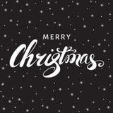 Литерность руки рождества на черной предпосылке с снежинками Стоковые Фотографии RF