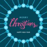 Литерность руки рождества розовая на предпосылке сини праздников Стоковые Изображения RF