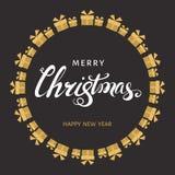 Литерность руки рождества с подарочными коробками золота на черном backgr Стоковые Изображения