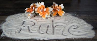 Литерность Ruhe в песке Стоковые Фото