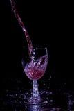 Лить красного вина Стоковая Фотография RF