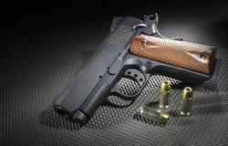 Личное огнестрельное оружие с пулями Стоковые Фото